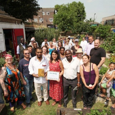 The Growing Kitchen Project was given the award by Dharmendra Kanini, director of England Big Lottery Fund at Wenlock Barn Estate in Napier Grove in Hoxton